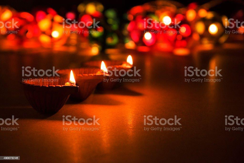 three beautiful diwali diya, selective focus, bokeh stock photo