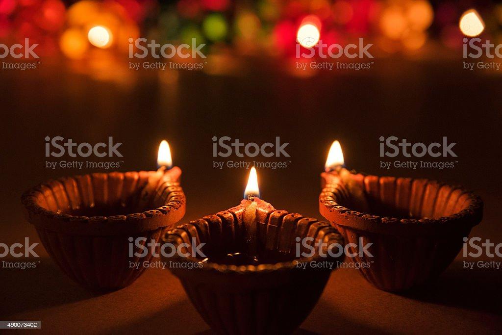 three beautiful diwali diya, selective focus with bokeh stock photo