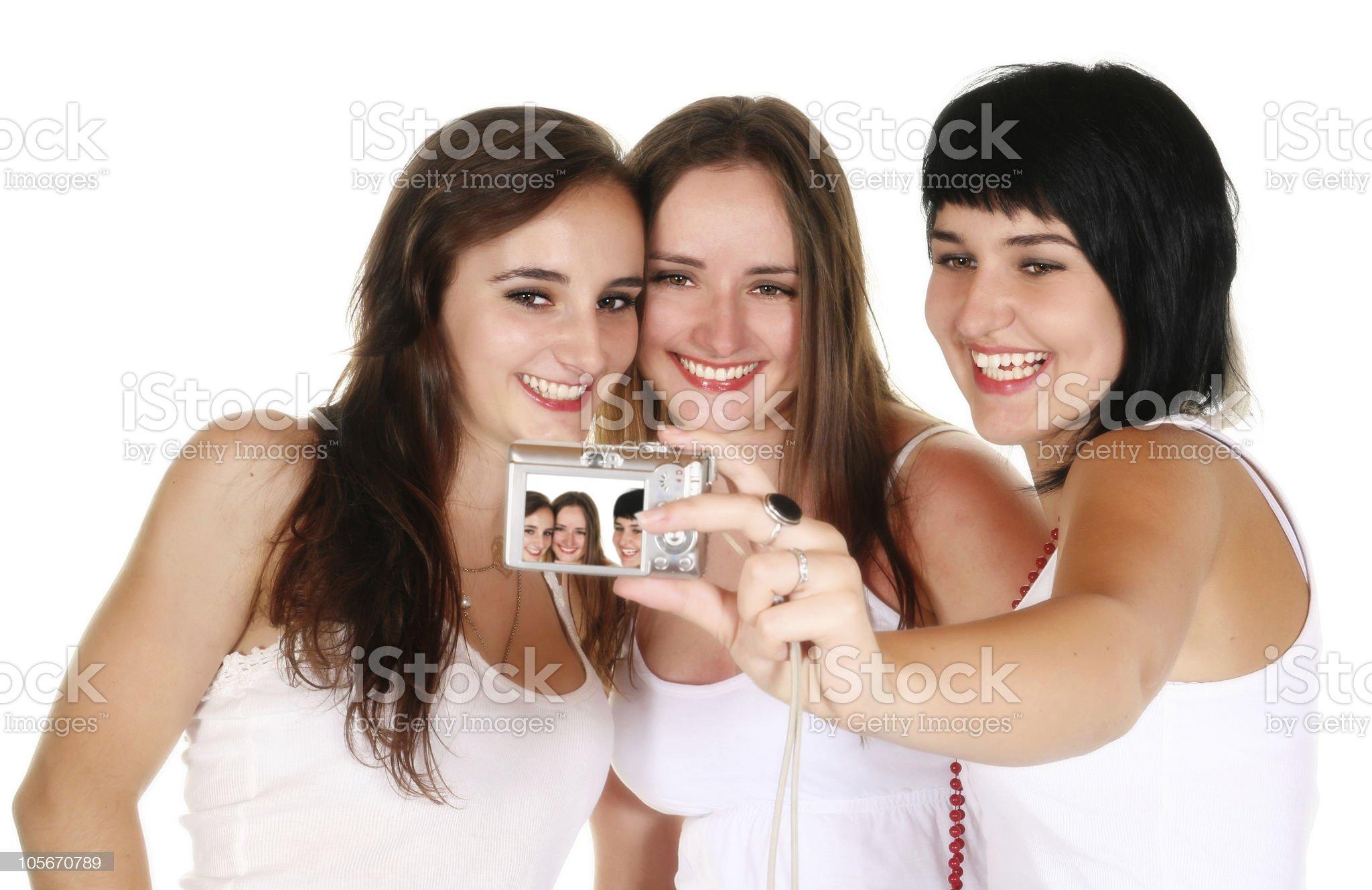 Three beautiful girls taking a photo royalty-free stock photo