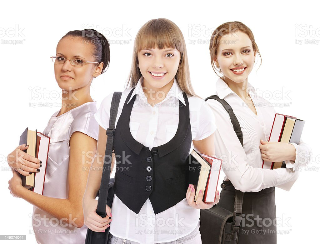 Three beautiful girls-students with textbooks royalty-free stock photo