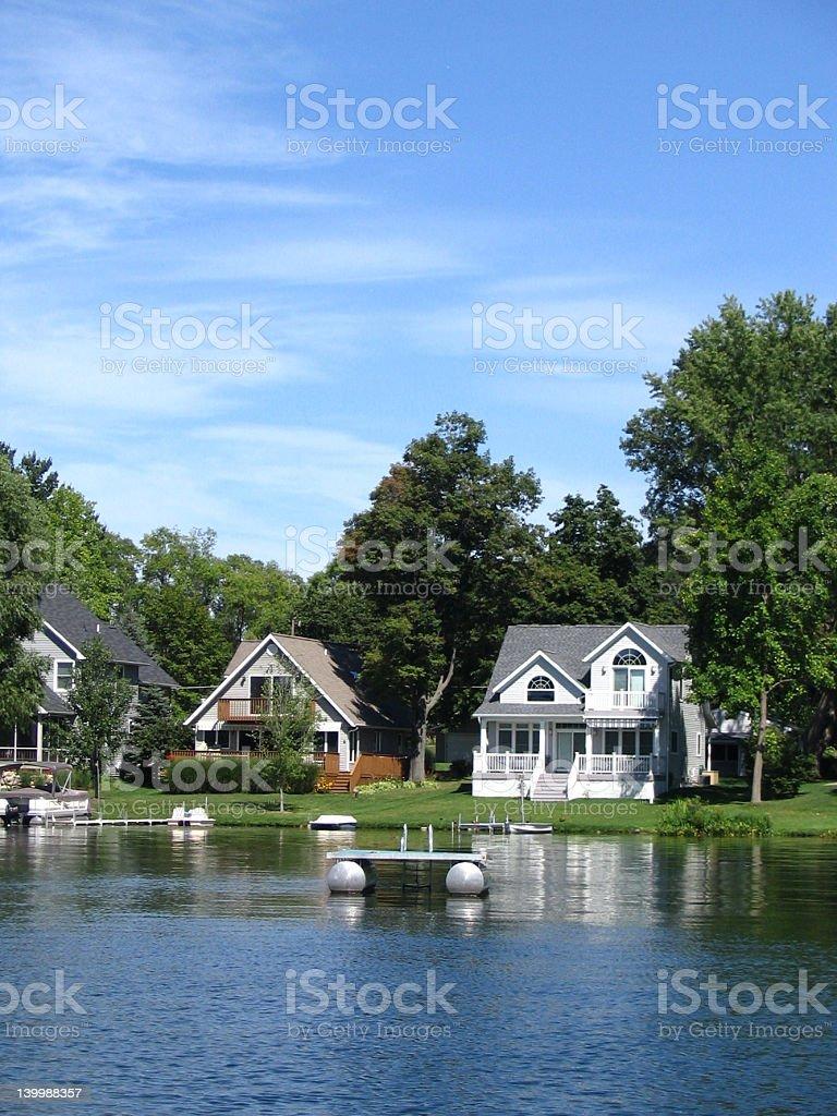 Three beautiful houses on the lake  stock photo