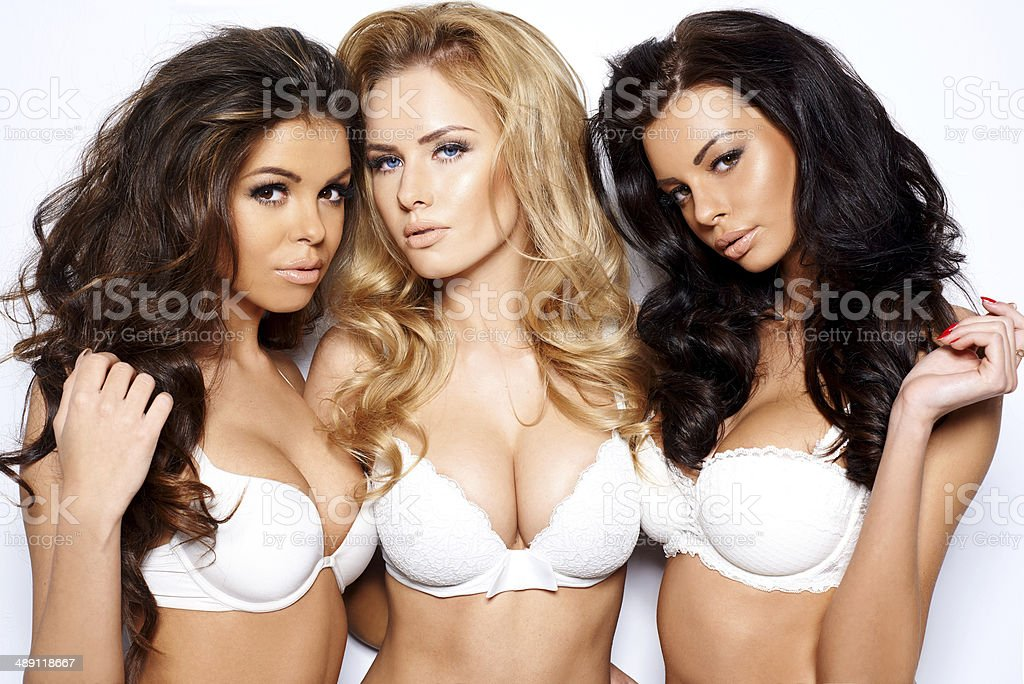 Three beautiful sexy curvaceous young women stock photo
