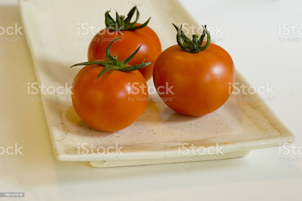 Three beautiful tomatoes royalty-free stock photo