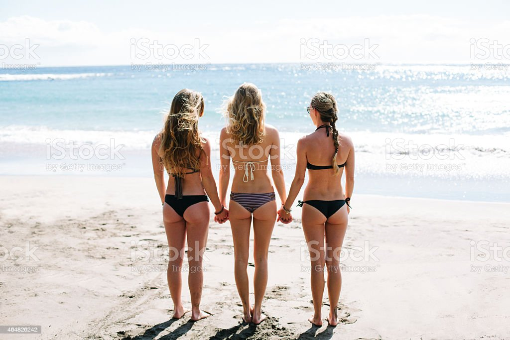 Three Beautiful Women at the Beach stock photo