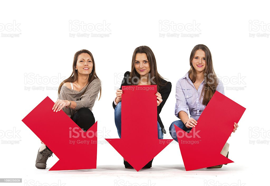 Three beautiful women holding arrows pointing down stock photo
