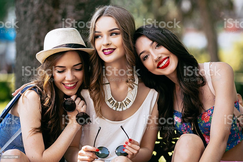 Three beautiful young girls stock photo