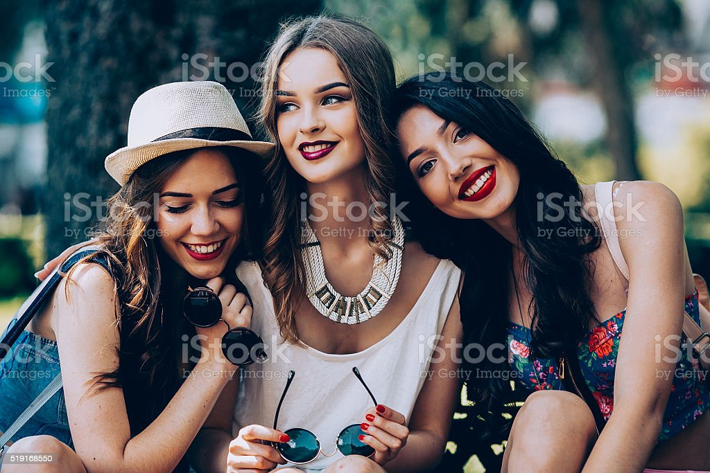 Three beautiful young girls stock photo
