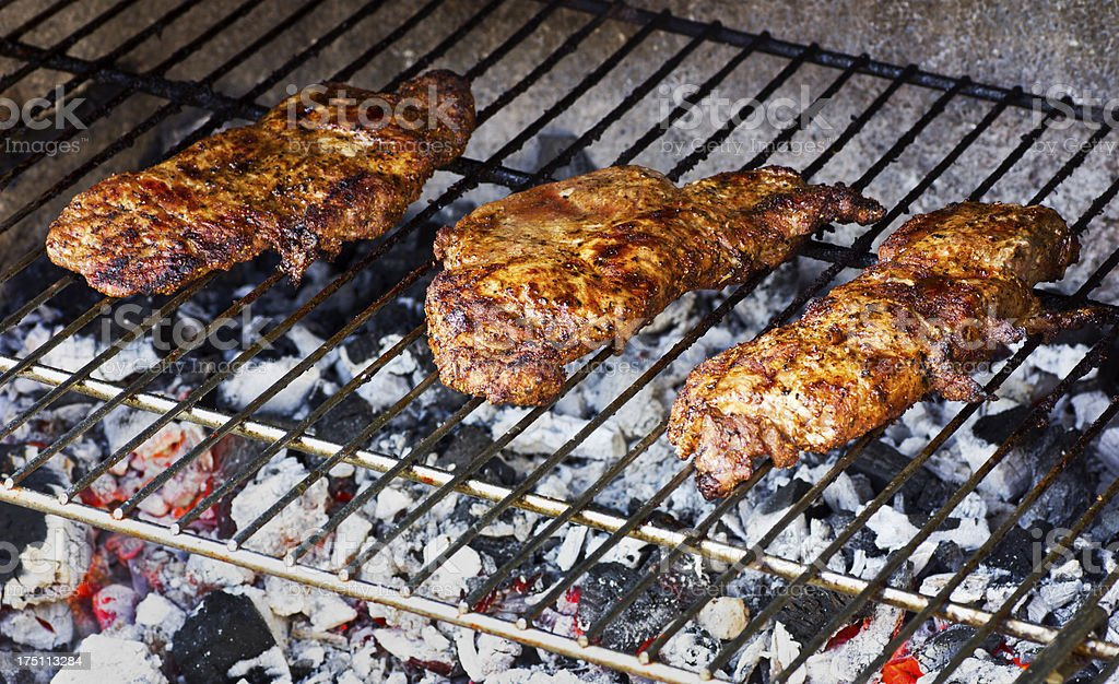 Three beefsteaks on the grill royalty-free stock photo