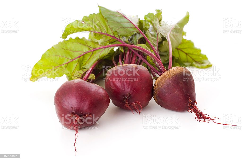 Three beetroots with leaves on white background stock photo