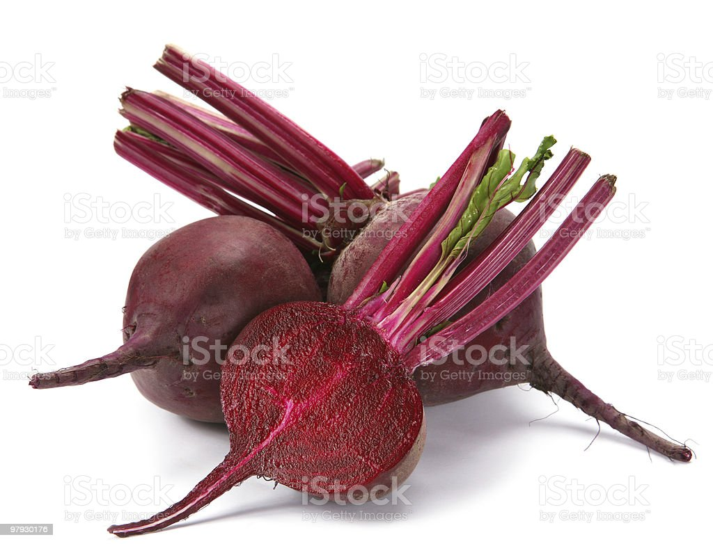 Three beets on a white surface royalty-free stock photo