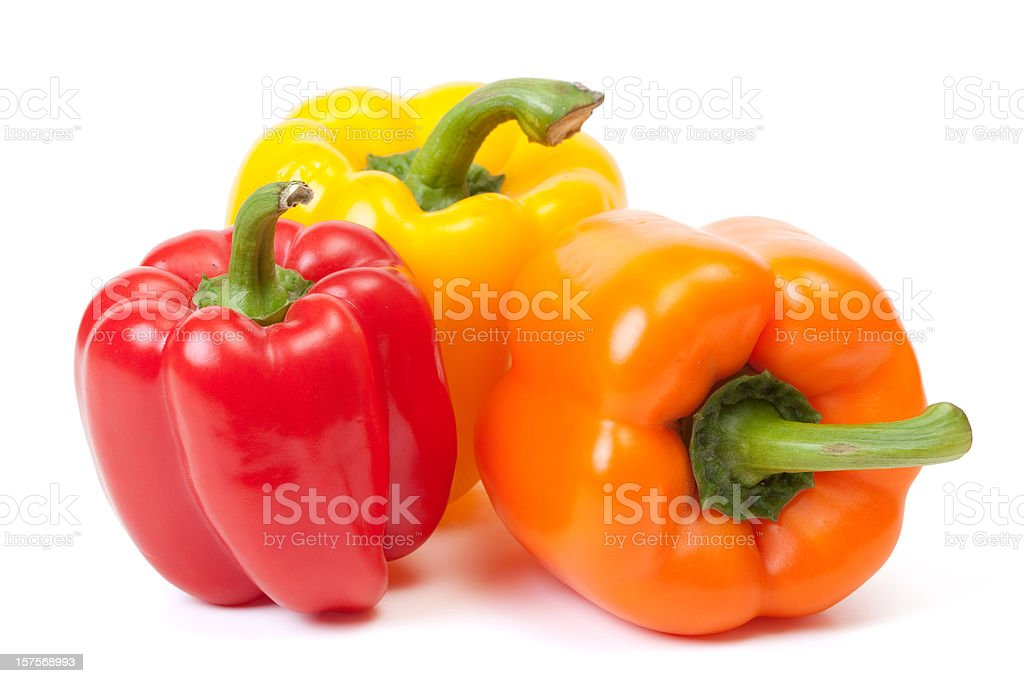 Three bell peppers, a red, a yellow and an orange one stock photo