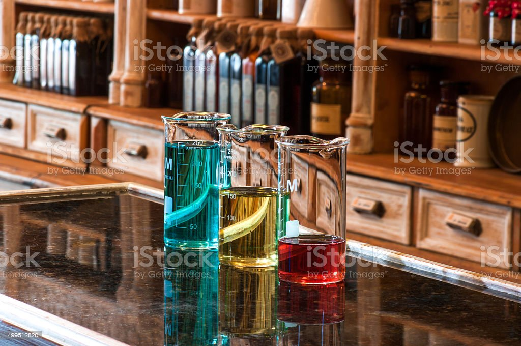 three berzelius glasses with colored liquid stock photo