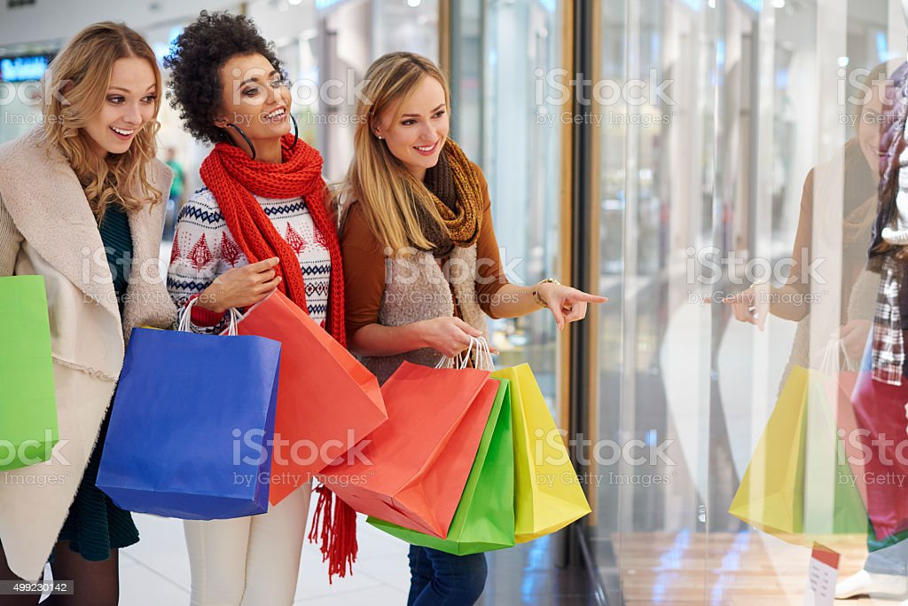Three best friends during Christmas shopping stock photo