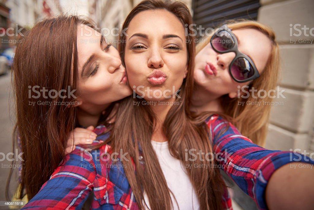 Three best friends taking selfie on the street stock photo