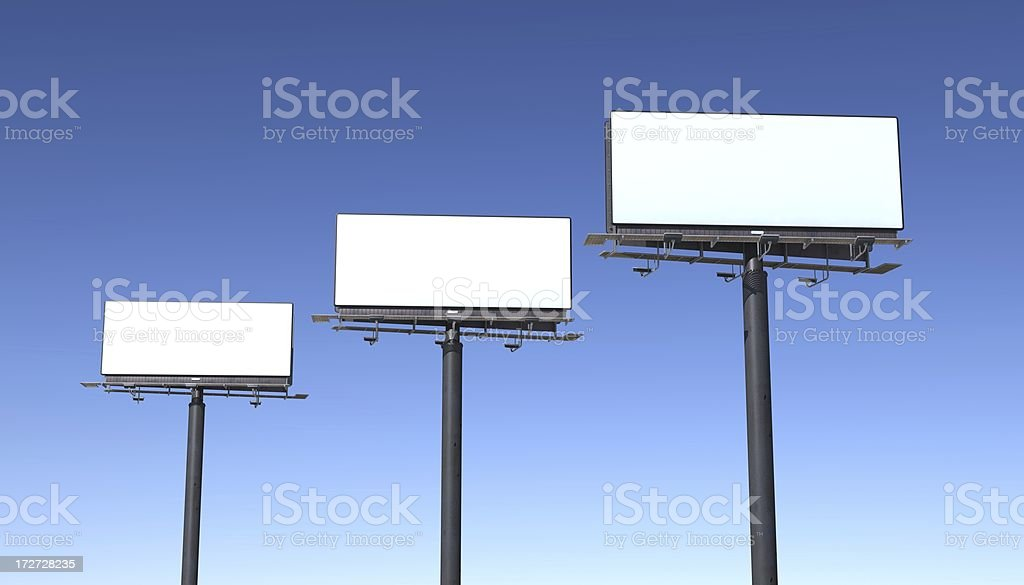 Three billboards isolated against blue sky stock photo
