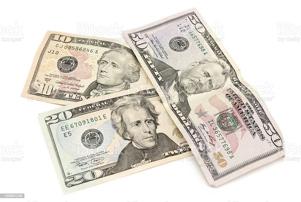 Three bills of US currency in various denominations royalty-free stock photo
