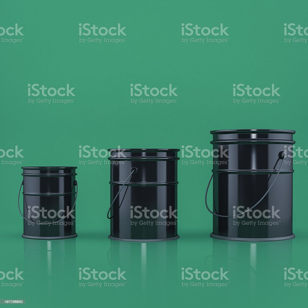 three black buckets on a green background front view stock photo