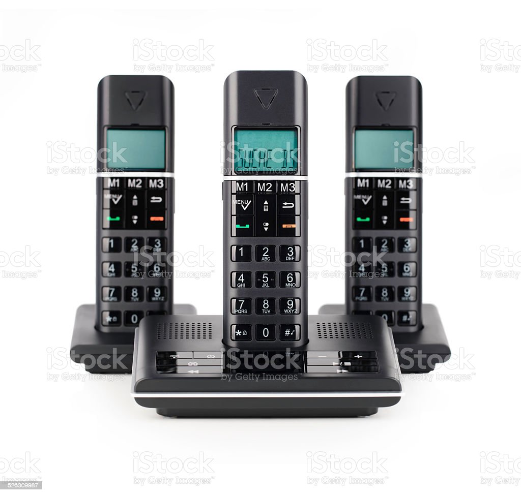Three black cordless telephones on white isolated stock photo