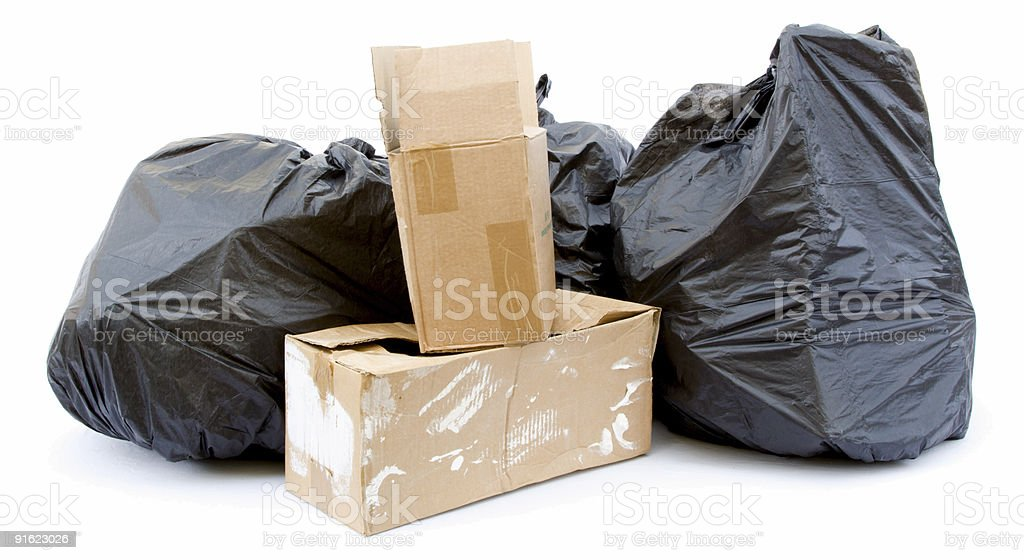 Three black garbage bags and waste cardboard boxes royalty-free stock photo