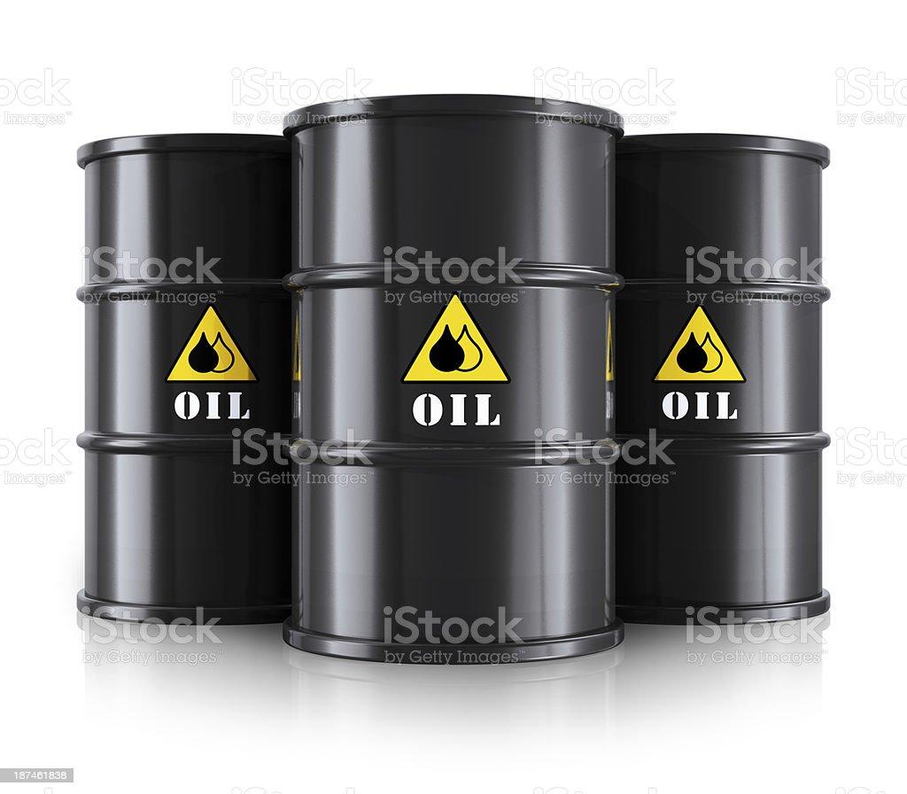 Three black oil barrels against a white background stock photo
