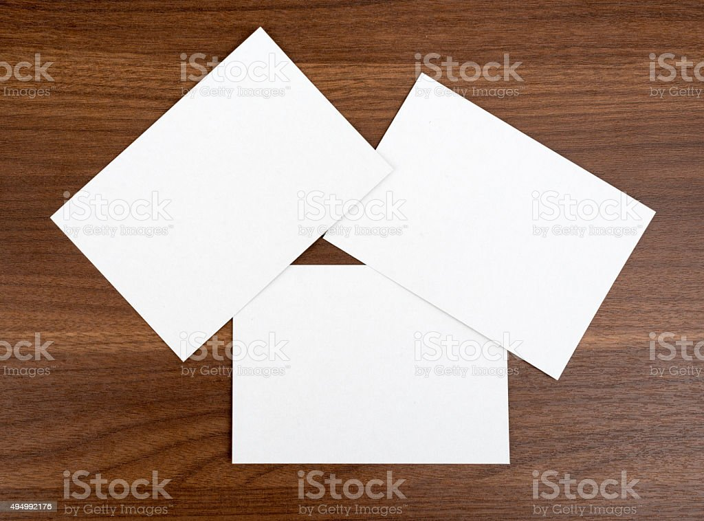 Three blank cards on wood table stock photo