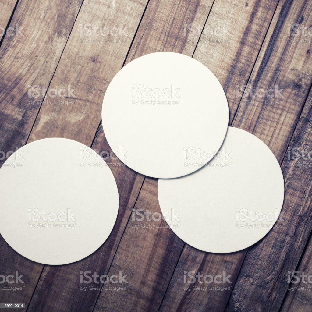 Three blank coasters stock photo