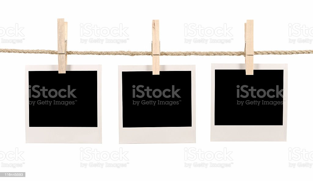 Three blank instant retro photos clipped on a washing line stock photo
