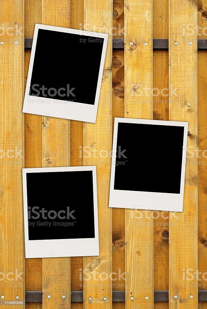 Three Blank Photos on Wood Background royalty-free stock photo