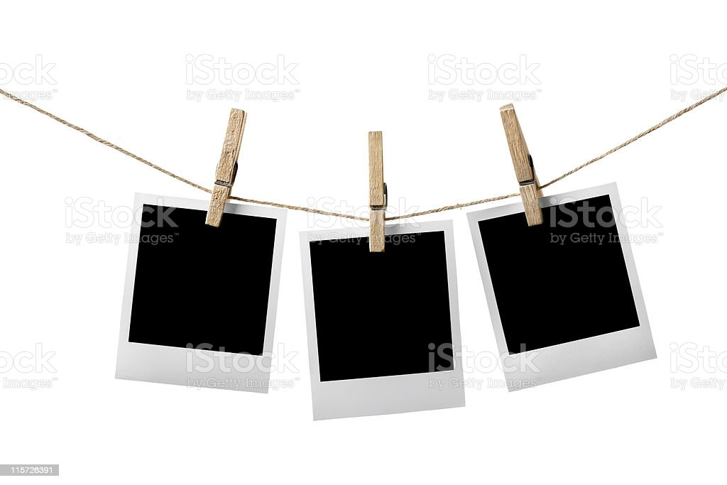 Three blank picture frames hanging on clothesline stock photo