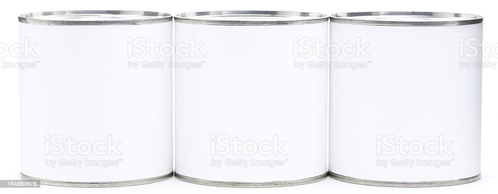 Three blank tin cans in a row royalty-free stock photo