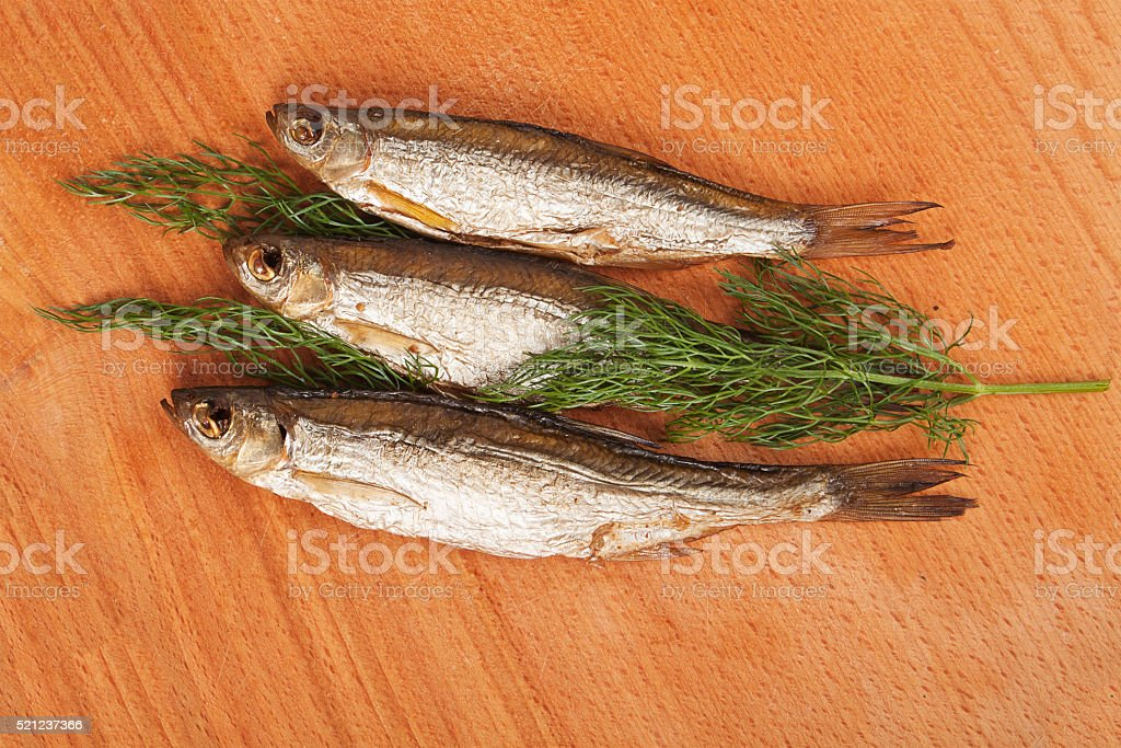 Three bloaters with dill stock photo
