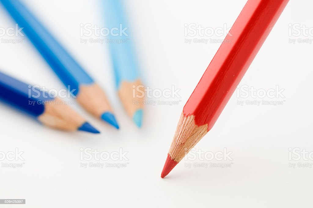 three blue and one red pencils stock photo