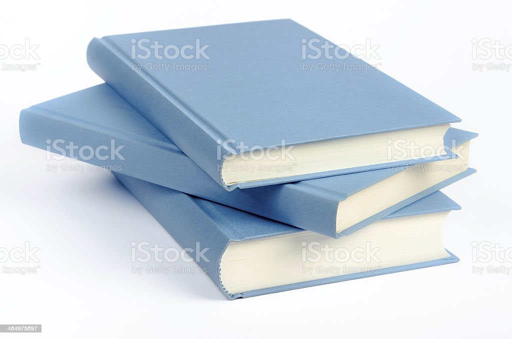 Three blue books on a white background royalty-free stock photo