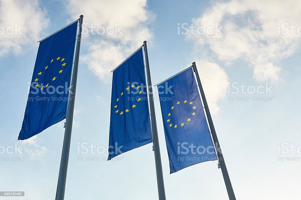Three blue European Union flags stock photo