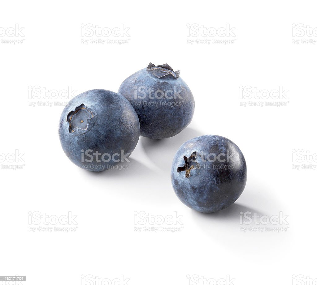 Three blueberries on a white background stock photo
