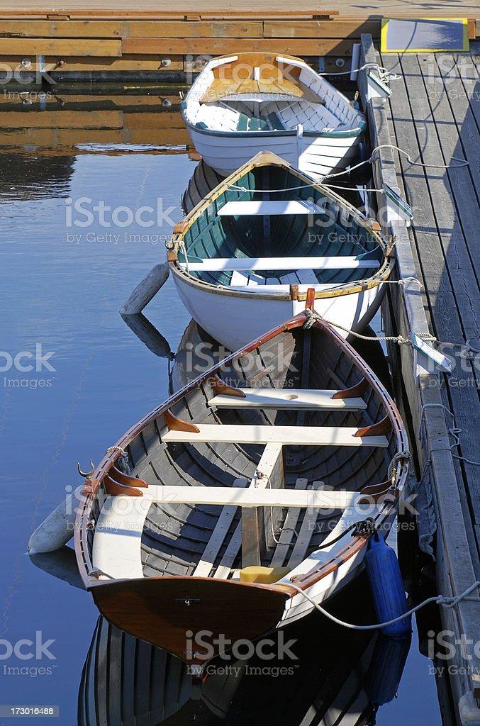 Three boats at lake marina stock photo