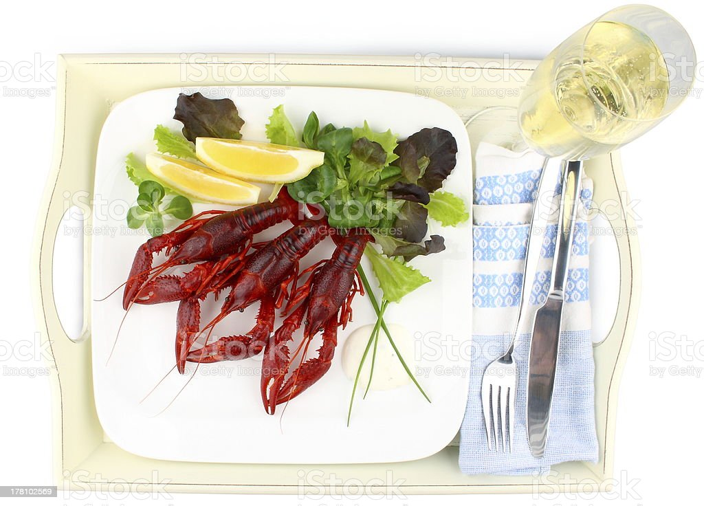 Three Boiled crayfish with lemon, lettuce and champagne royalty-free stock photo