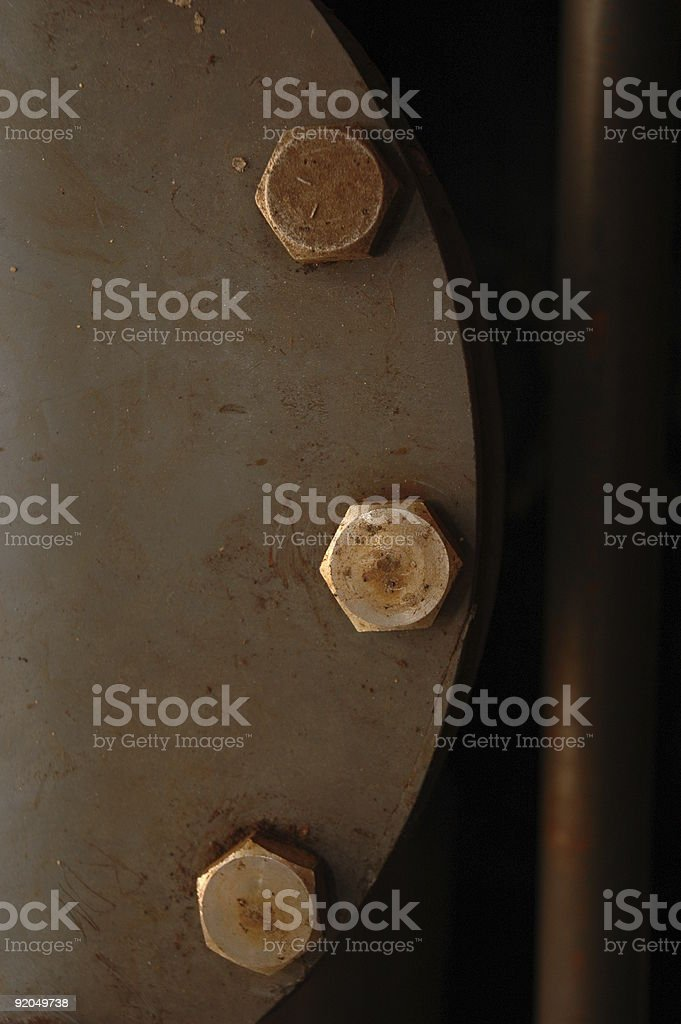 Three bolt nuts in end of PVC flange pipe royalty-free stock photo