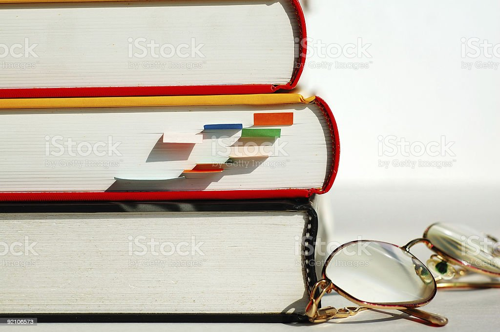 Three books and glasses stock photo