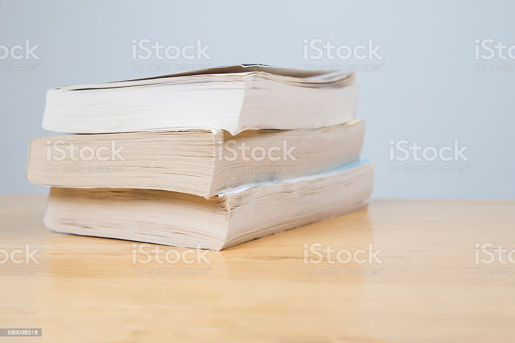 Three books in a pile stock photo