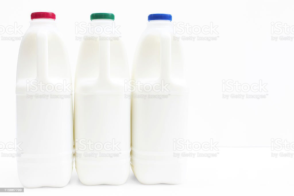 Three bottle of fresh milk on white with path stock photo