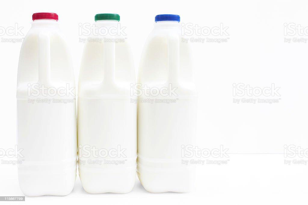 Three bottle of fresh milk on white with path stock photo