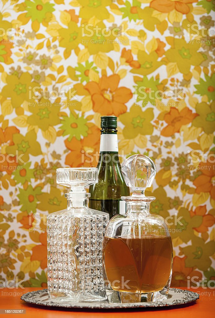 Three Bottles of Alcohol with Different Shapes Floral Wallpaper Background royalty-free stock photo