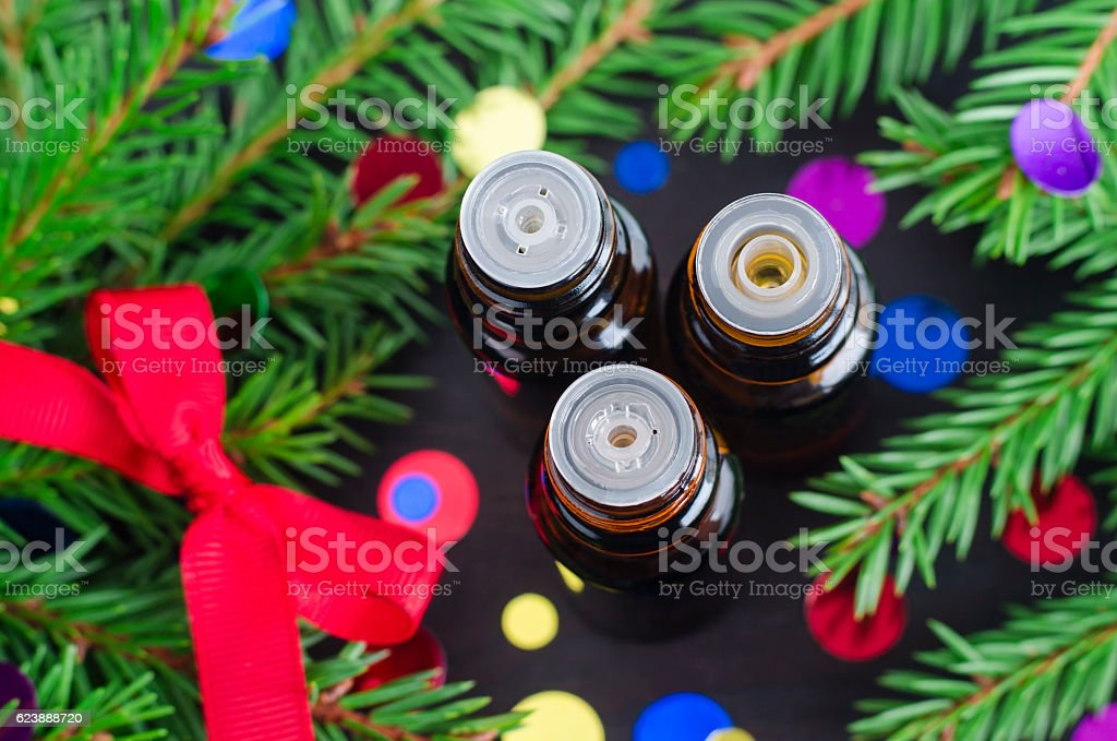 Three bottles of essential oil. Christmas aromatherapy stock photo