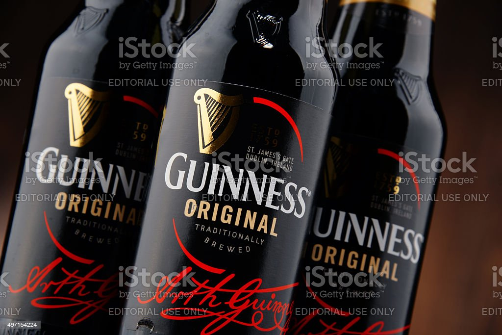 Three bottles of Guinness beer stock photo