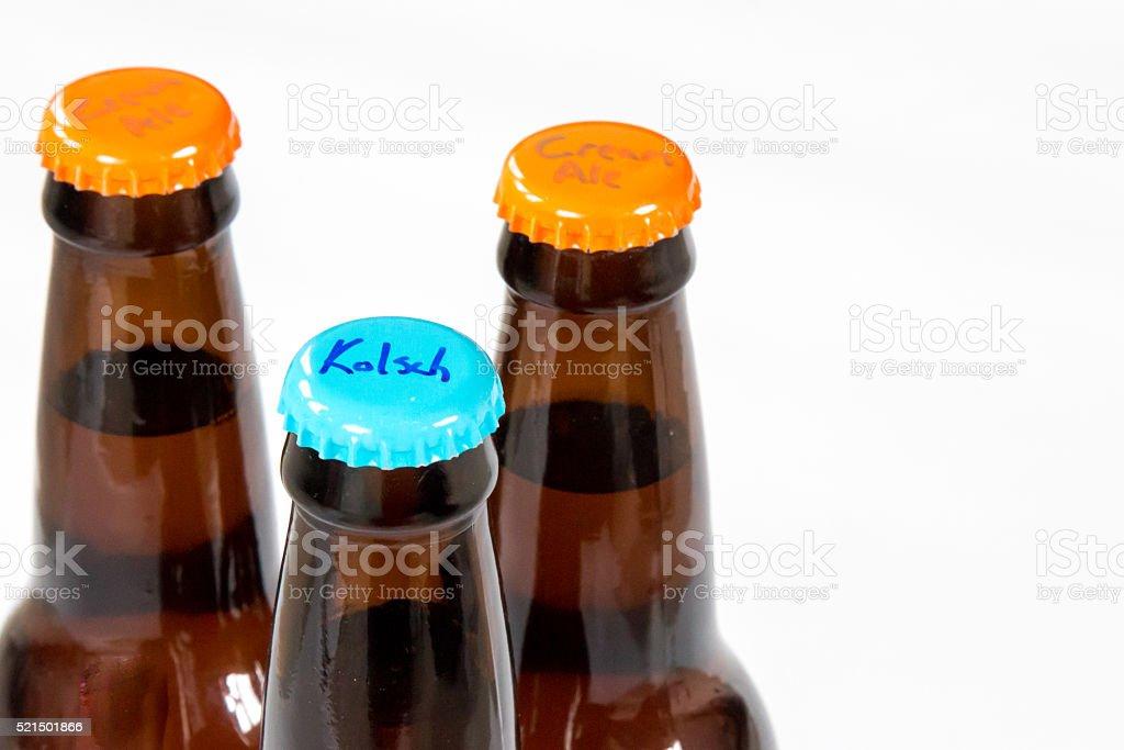 Three bottles of homebrew beer against white stock photo