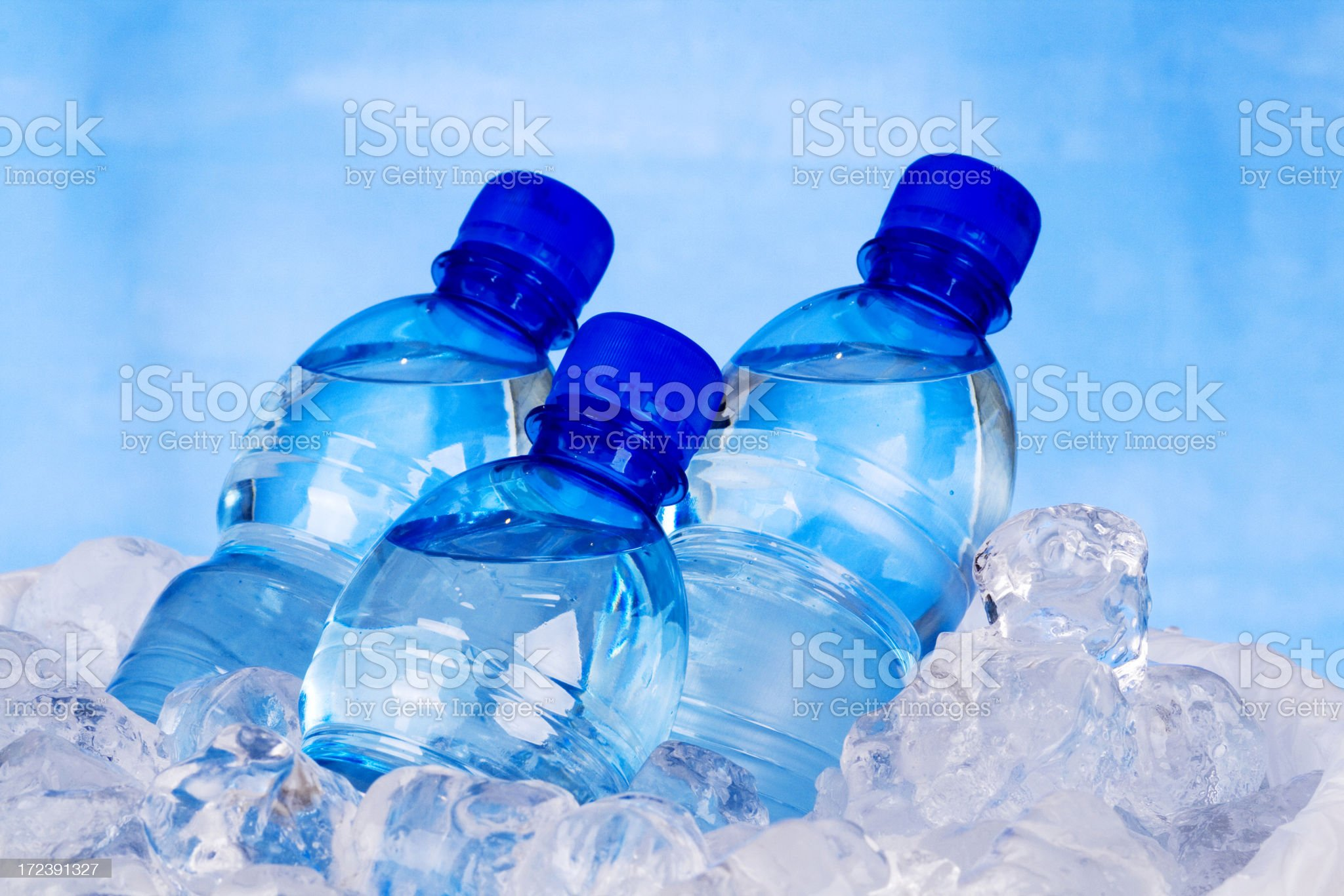 Three bottles of water and ice royalty-free stock photo