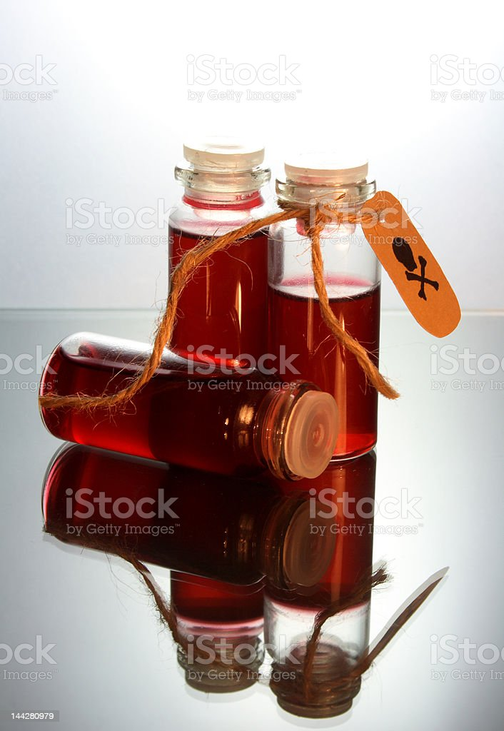 three bottles with poison stock photo