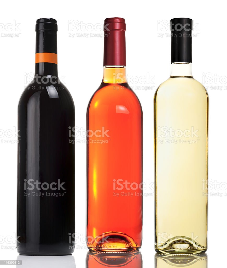 Three bottles with red, pink and white wines royalty-free stock photo