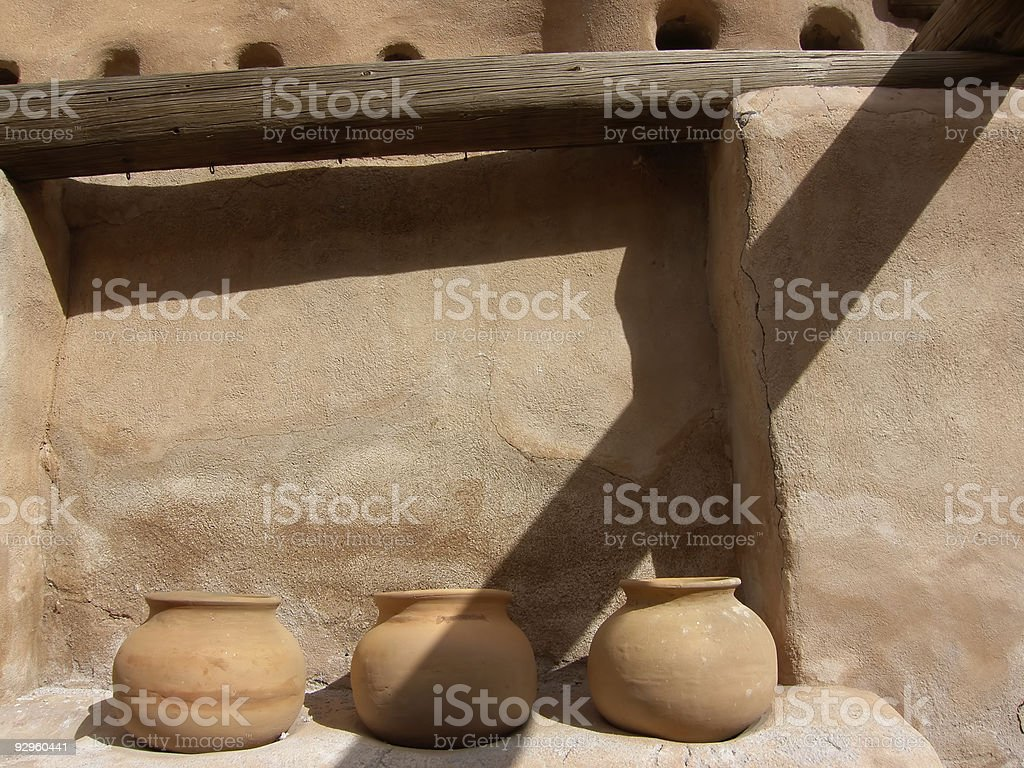Three Bowls against ancient stucco building stock photo